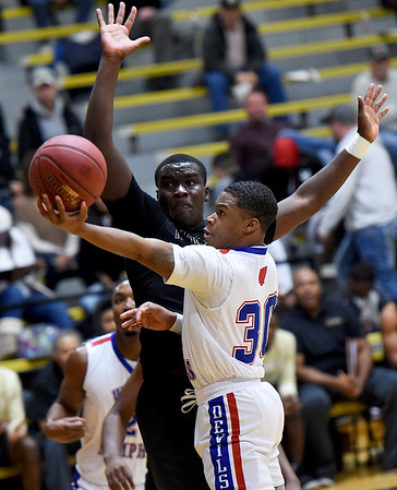 West Memphis guard Kayalan Sykes (30) challenges Memphis Mitchell's Terrence Rucker during their championship game in the boys gold division of the Neosho Holiday Classic on Saturday at Neosho High School.<br /> Globe | Laurie Sisk