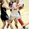 Webb City's Madeline Hayes (12) fights to get past Fair groves' Cydeny Fullerton (left) and Alana Findley during their game on Thursday night at Webb City.<br /> Globe | Laurie Sisk