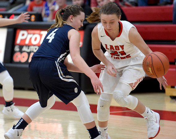Baxter Springs' Abbey Underhill (21) tries to get past Galena's Addysin Scarrow (4) during their game on Tuesday night at BSHS.<br /> Globe | Laurie Sisk