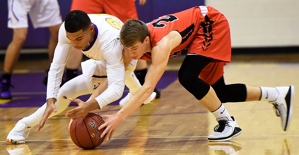 From the left: Thomas Jefferson's Matthew Dohman and Sheldon's Judd Loyd battle for a loose ball during their game on Thursday night at Thomas Jefferson.<br /> Globe | Laurie Sisk