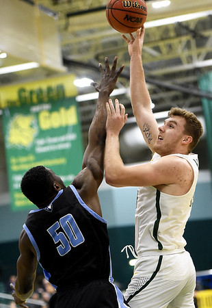 Missouri Southern's Cam Martin scores and draws a foul on Upper Iowa's Munachiso Okonkwo (50) during their game on Wednesday afternoon at Leggett & Platt.<br /> Globe | Laurie Sisk