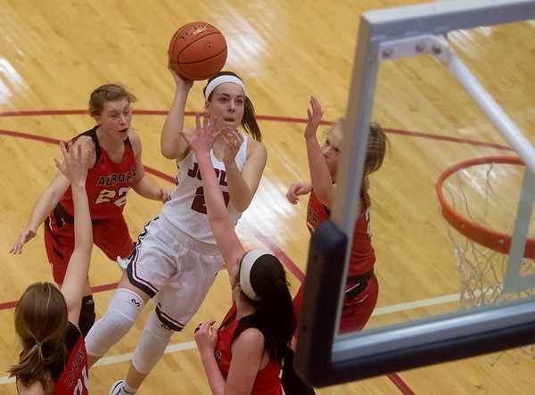 Joplin's Brynn Driver goes up for a shot in the middle of the Aurora defense during Monday's game at Joplin High School.<br /> Globe | Roger Nomer