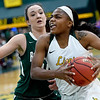 Missouri Southern's Chasidee Owens, right, drives past Northeastern State's Cailyn Long during their game on Saturday at Leggett & Platt.<br /> Globe | Laurie Sisk