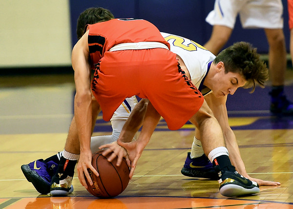 Thomas Jefferson's Chase Kellenberger (32) knocks the ball away from Sheldon's Clayton Loyd (3)  during their game on Thursday night at Thomas Jefferson.<br /> Globe | Laurie Sisk
