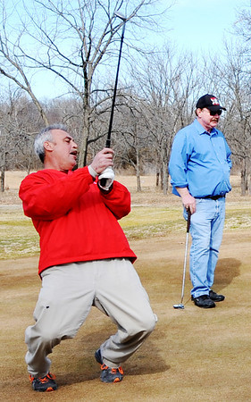 "Globe/T. Rob Brown<br /> Ron ""Bullsie"" Oney II, of Webb City, reacts to just missing a birdie shot as Mike Connelly, of Halltown, looks on as they take advantage of the unseasonably-warm weather to play a round of golf at Range Line Golf Center's nine-hole course Wednesday, Feb. 1, 2012."