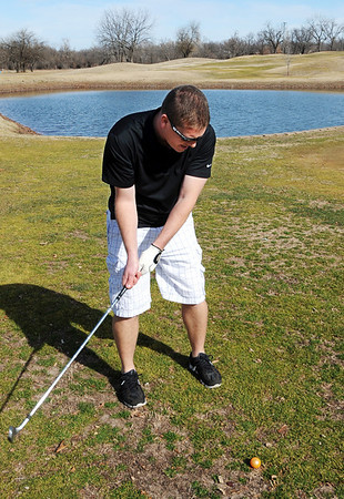 Globe/T. Rob Brown<br /> Kyle Darker, of Joplin, takes advantage of the unseasonably-warm weather to play a round of golf, in shorts, with friends at Range Line Golf Center's nine-hole course Wednesday, Feb. 1, 2012.