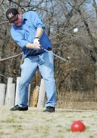 Globe/T. Rob Brown<br /> Mike Connelly, of Halltown, takes advantage of the unseasonably-warm weather to play a round of golf with friends at Range Line Golf Center's nine-hole course Wednesday, Feb. 1, 2012.
