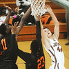 Globe/Roger Nomer<br /> Joplin's Spencer Layne has a shot blocked by Waynesville's Kellieon Williams (11) and Juwan Morgan (23) during Friday's game.