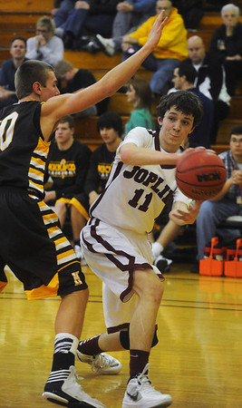 Globe/Roger Nomer<br /> Joplin's Dillon McVay makes a pass around Kickapoo's Tyler Bussell during Friday's game.