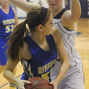Globe/Roger Nomer<br /> Galena's Abby Shelton plays close defense on Riverton's Addison Berry during Tuesday's game.