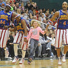 Globe/Roger Nomer<br /> Emma Bollinger, 10, Carthage, skips around the court with the Globetrotters during the game, much to the consternation of the referee on Wednesday at the Leggett and Platt Athletic Center.