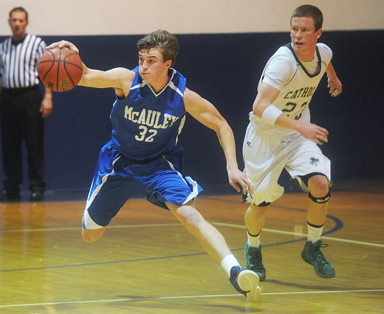 Globe/Roger Nomer<br /> McAuley's Cole Lowry collects a loose ball in front of Springfield Catholic's Eric Smith during Saturday's game in the McAuley Warrior Classic.