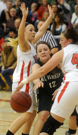 Globe/Roger Nomer<br /> Mt. Vernon's Mackenzie Farmer finds space to make a pass between Carl Junction's Bryce Boyd, left, and Katie Skaggs during Friday's game.