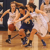 Globe/Roger Nomer<br /> Galena's Brittany Allen, left, and Bailey Titus fight with Riverton's MacKenzie Dunbar for a loose ball during Tuesday's game.