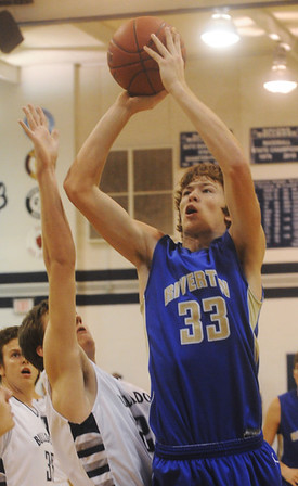 Globe/Roger Nomer<br /> Riverton's Grant North takes a shot over Galena's Logan Johnson during Tuesday's game.