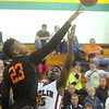 Globe/Roger Nomer<br /> Waynesville's Juwan Morgan blocks a shot by Joplin's Charlie Brown during Friday's game.