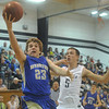 Globe/Roger Nomer<br /> Riverton's Gavin Forbes drives around Galena's Nick Sivert during Tuesday's game.