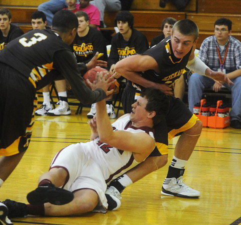Globe/Roger Nomer<br /> Joplin's Tucker Wallace fights for a loose ball with Kickapoo's Tyston Batiste (3) and Tyler Bussell during Friday's game.