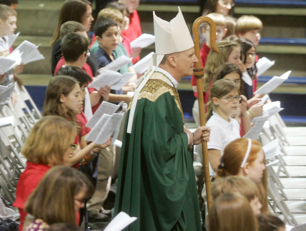 Globe/Roger Nomer<br /> The Rev. James Van Johnston, bishop of Springfield/Cape Girardeau Diocese of Southern Missouri, enters the McAuley High School gym for an all-schools mass to celebrate Catholic Schools Week on Tuesday.