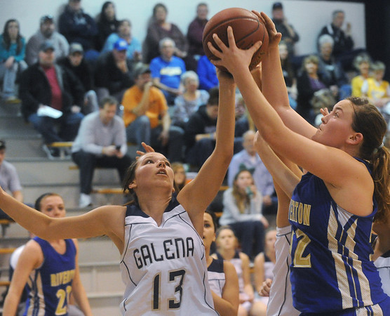 Globe/Roger Nomer<br /> Riverton's Mattea Cupp pulls a rebound away from Galena's Jordan Roberts during Tuesday's game.