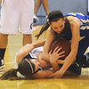 Globe/Roger Nomer<br /> Galena's Haley Hall and Riverton's Hanna White fight for a loose ball during Tuesday's game.