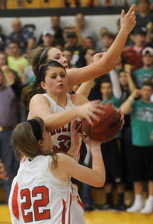 Globe/Roger Nomer<br /> Carl Junction's Brenlee McPherson, center, takes a rebound away from teammate Maria Chism and Mt. Vernon's Laynie Dake during Friday's game.