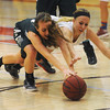 Globe/Roger Nomer<br /> Mt. Vernon's Megan Pope battles her hair and Carl Junction's Bryce Boyd to reach a loose ball during Friday's game.