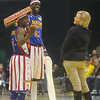 Globe/Roger Nomer<br /> Globetrotter Special K presents Dianna Quirin, Parsons, with a gift of bite-sized chocolate in the form of Too Tall during Wednesday's game at the Leggett and Platt Athletic Center.
