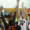 Globe/Roger Nomer<br /> Joplin's Adam St. Peter puts up a shot over Waynesville's Juwan Morgan during Friday's game.