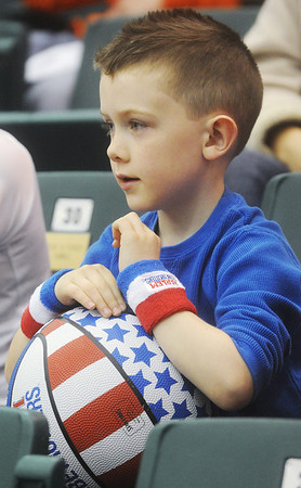 Globe/Roger Nomer<br /> With his eyes glued to the court, Brogan Shaw, 6, Parsons, watches the Harlem Globetrotters as they play at the Leggett and Platt Athletic Center on Wednesday.