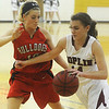 Globe/Roger Nomer<br /> Joplin's Marissa Queen drives against Carl Junction's Sydney Kock during Tuesday's game.