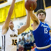 Greenfield's Colin White (15) rejects a shot attempt by Diamond's Carter Prewitt (15) during their game on Friday night at Diamond.<br /> Globe | Laurie Sisk