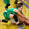 Pierce City's Ragan Blinzler, front and PLane Skiles dive for a loose ball during their Class 2 District 12 final on Friday night at Sarcoxie High School.<br /> Globe | Laurie Sisk