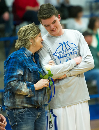 McAuley senior Tommy Doyle shares a moment with his mother, Tish Doyle, on Senior Night at McAuley.<br /> Globe | Laurie Sisk