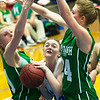 McAuley's Abby Schiefelbein (24) tries to squeeze through Bronaugh's Riley Knapp (21) and Katey Rider (24) during their game on Tuesday night at McAuley.<br /> Globe | Laurie Sisk