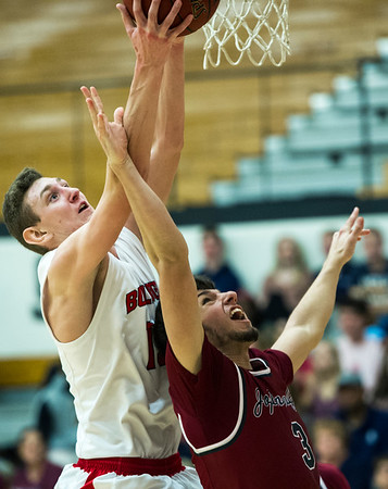 Carl Junction's Will Bebee (13) puts up a shot as Joplin's Logan Swadner (3) defends during their game on Friday night at CJHS.<br /> Globe | Laurie Sisk