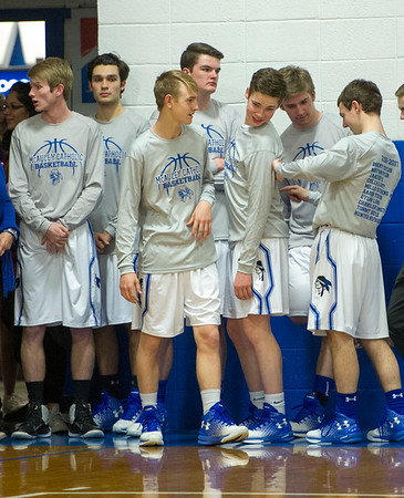 The seven McAuley senior boys wait for the start of their game on Tuesday night at McAuley.<br /> Globe | Laurie Sisk