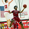 Joplin's Evan Guillory (21) puts up a shot as Carl Junction's Will Bebee (13) defends during their game on Friday night at CJHS.<br /> Globe | Laurie Sisk