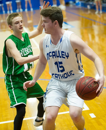 McAuley's Jake Doyle (15) ) tries to get past Bronaugh's Carson Gray (15) during their game on Tuesday night at McAuley.<br /> Globe | Laurie Sisk