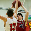 Joplin's Austin Higdon (45) puts up a shot as Carl Junction's Will Bebee (13) defends during their game on Friday night at CJHS.<br /> Globe | Laurie Sisk