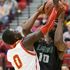 Missouri Southern's LJ Ross (10) battles Pittsburg State's Jabari Antwine (0) for a rebound during their game on Saturday at John Lance Arena.<br /> Globe | Laurie Sisk