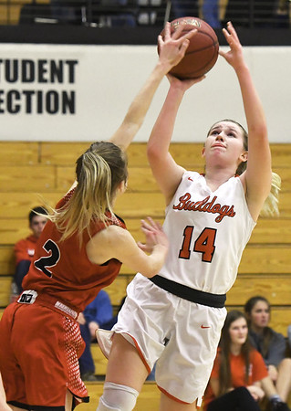 Carl Junction's Taylor Hughes (14) puts up a shot as Ozark's Anna Hitt (2) defends during their game on Thursday night at CJHS.<br /> Globe   Laurie Sisk