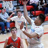 Webb City's Tavaris Young (2) drives to the basket as Nixa's Luke Roemen, front, and Jack Sanders look on during their game on Friday night at the Cardinal Dome.<br /> Globe | Laurie Sisk