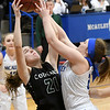 College Heights' Grace Bishop (21) and McAuley's Abby Schiefelbein (24) compete for a rebound during their game on Thursday night at McAuley.<br /> Globe | Laurie Sisk