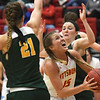 Pittsburg State's Mikaela Burgess (15) gets past Missouri Southern's Desirea Buerge (21) and Kamiron Luptak for a score during their game on Saturday at John Lance Arena.<br /> Globe | Laurie Sisk