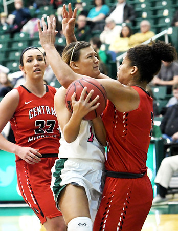 Missouri Southern's Dru Clark (1) gets fouled by Central Missouri's Kayonna Lee (3) as CMSU's Jolene Shipps (23) looks on during their game on Saturday at Leggett & Platt.<br /> Globe | Laurie SIsk