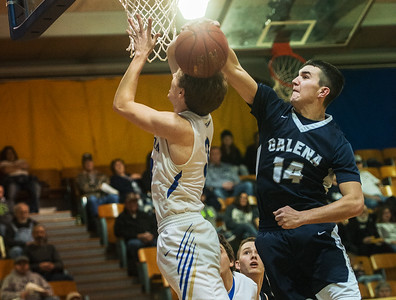 Galena's Garrett Hall blocks a shot from Riverton's Gage Kirby during Tuesday's game in Riverton. Globe | Roger Nomer