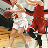 Carl Junction's Shila Winder (12) tries to get past Ozark's Madi Braden (13) on a fast break during their game on Thursday night at CJHS.<br /> Globe | Laurie Sisk