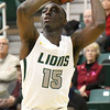 Missouri Southern's Elyjah Clark shoots a record breaking three-pointer during the Lions game against Central Missouri on Saturday at Leggett & Platt.<br /> Globe | Laurie SIsk