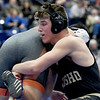 Neosho's Joey Williams, right, battles Republic's John Hickman during their 182-lb. match on Friday at the Class3, District 3 tournament at Carthage High School.<br /> Globe | Laurie Sisk